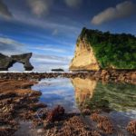 Discover stunning limestone cliffs at Atuh Beach